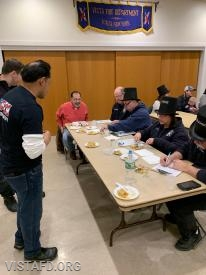 Lt. Wilmer Cervantes and Foreman Mike Canil of Platoon 3 presenting their meal to the cooking competition judges