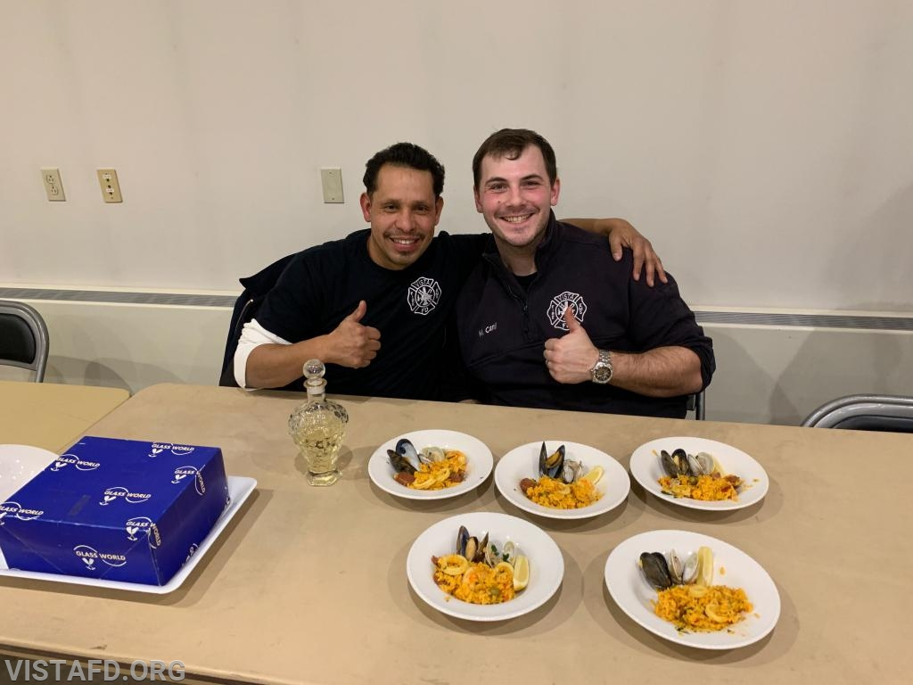 Lt. Wilmer Cervantes and Foreman Mike Canil of Platoon 3 with their cooking competition meal