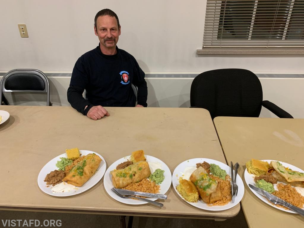 Lt. Phil Katz of Platoon 4 with their cooking competition meal