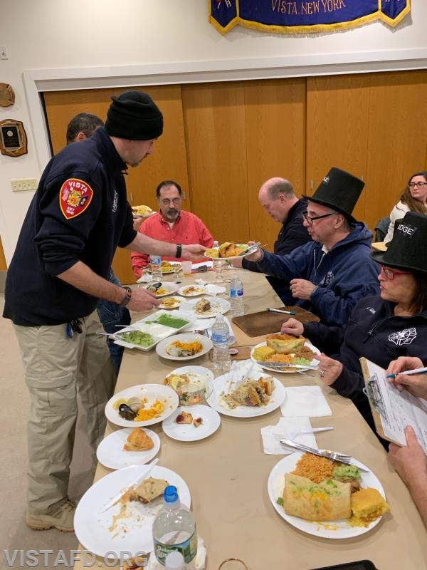 Lt. Phil Katz and Foreman Adam Bartley of Platoon 4 presenting their meal to the cooking competition judges