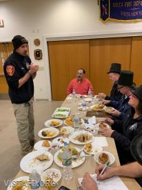 Foreman Adam Bartley of Platoon 4 presenting their meal to the cooking competition judges