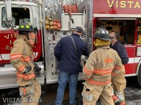 Vista Firefighters going over how to pump Engine 142