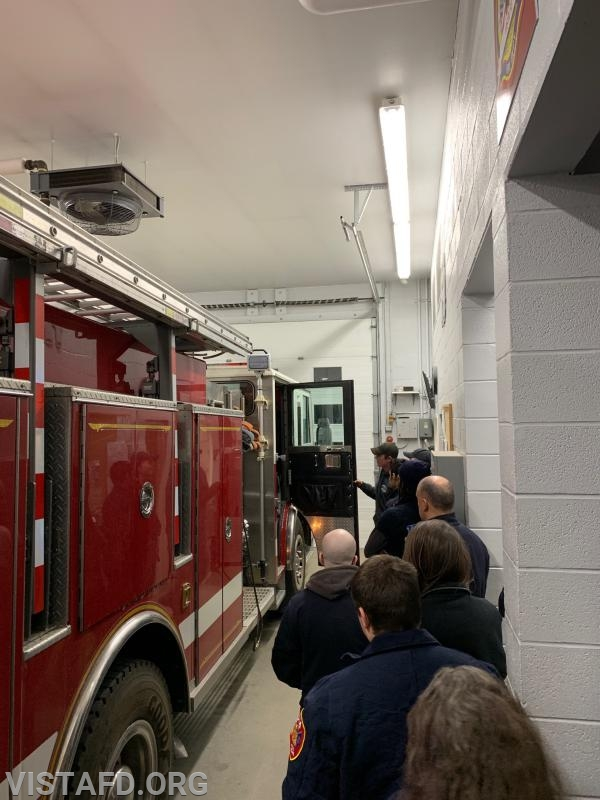 Foreman Patrick Healy going over the equipment on Engine 143