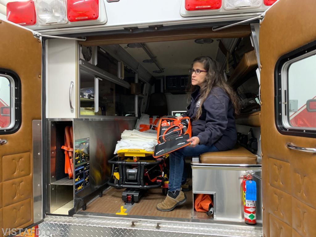 Captain Debbie Ferman going over the equipment on Ambulance 84B2