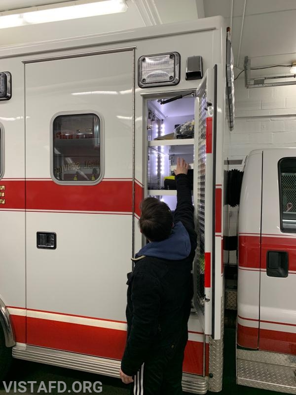 Foreman Karen Lilly going over the equipment on Ambulance 84B1