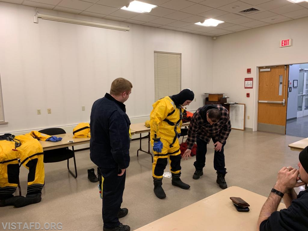 Vista Fire Department personnel learning how to put on the ice water rescue equipment