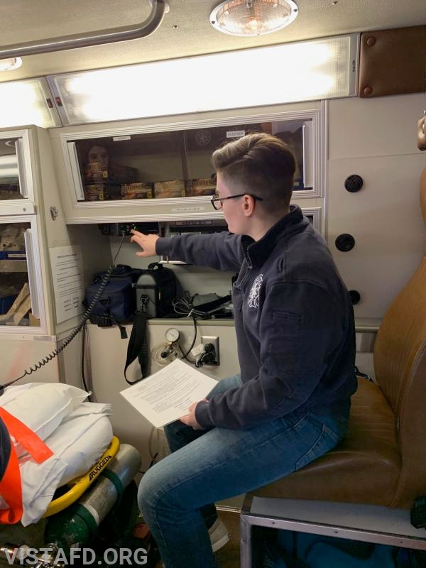 Foreman Karen Lilly reviewing hospital communications in Ambulance 84B2