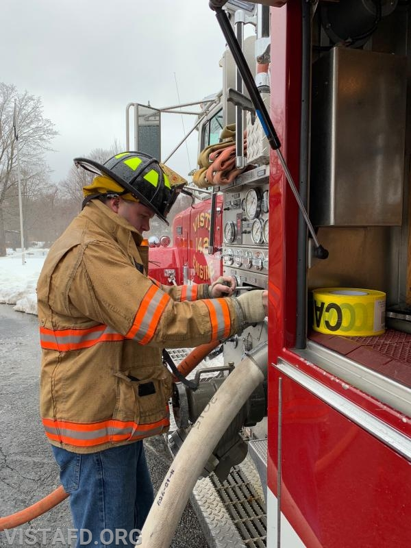 Firefighter Dan Gjodesen practicing how to pump Engine 142