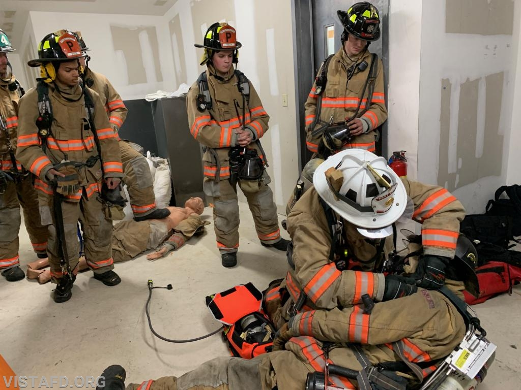 Vista Firefighters reviewing several different F.A.S.T packaging techniques