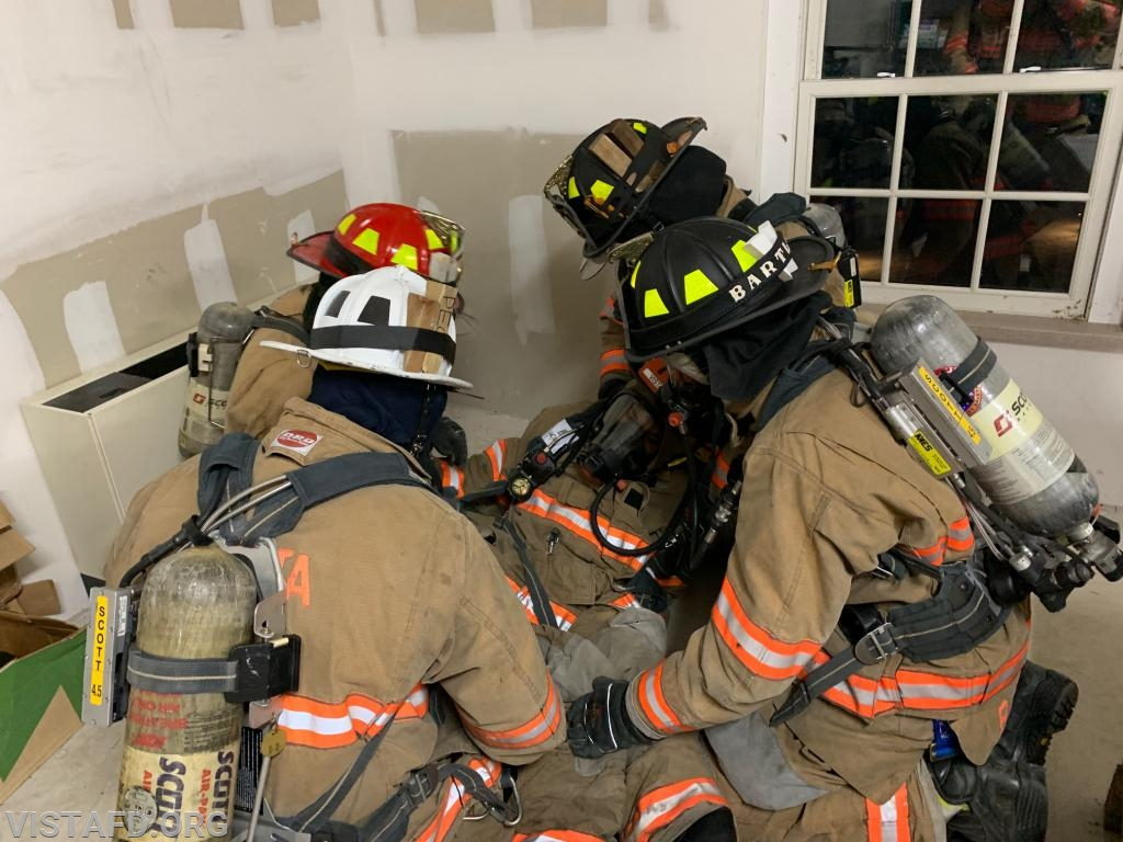 Vista Firefighters practicing how to package a downed Firefighter