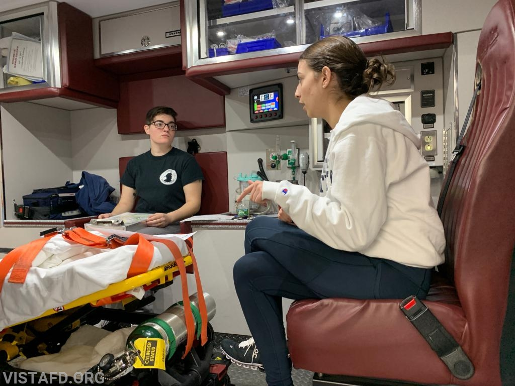Foreman Karen Lilly going over radio operations while enroute to the hospital