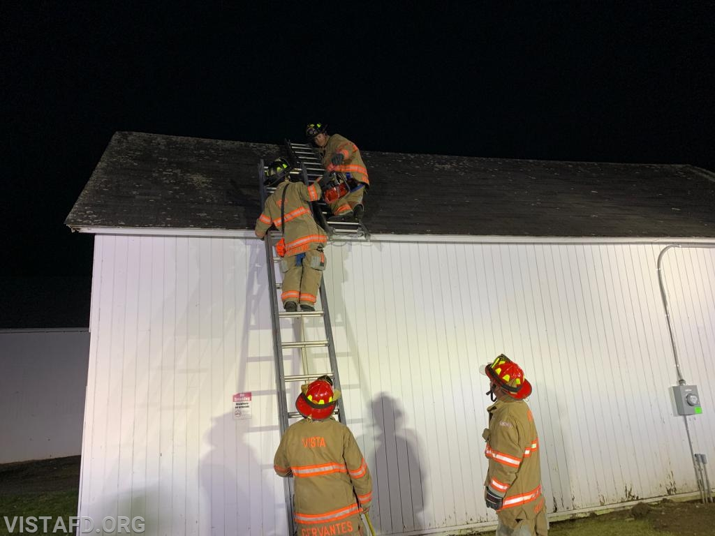 Vista Firefighters practicing ladder operations