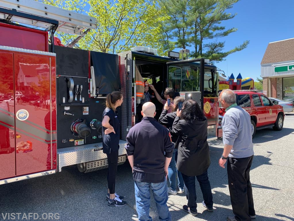 Firefighter/EMT Olivia Buzzeo and Firefighter/EMT Ryan Ruggiero giving tours of Engine 141