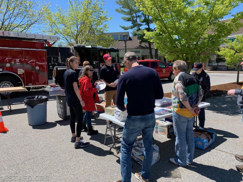 "Vista Fire Department members serving hamburgers and hot dogs to the public during the ""Fine Arts & Craft Fair"""