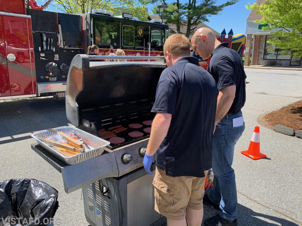 "Asst. Chief Mike Peck and Lead Foreman Marc Baiocco handling grill duties during the ""Fine Arts & Craft Fair"""