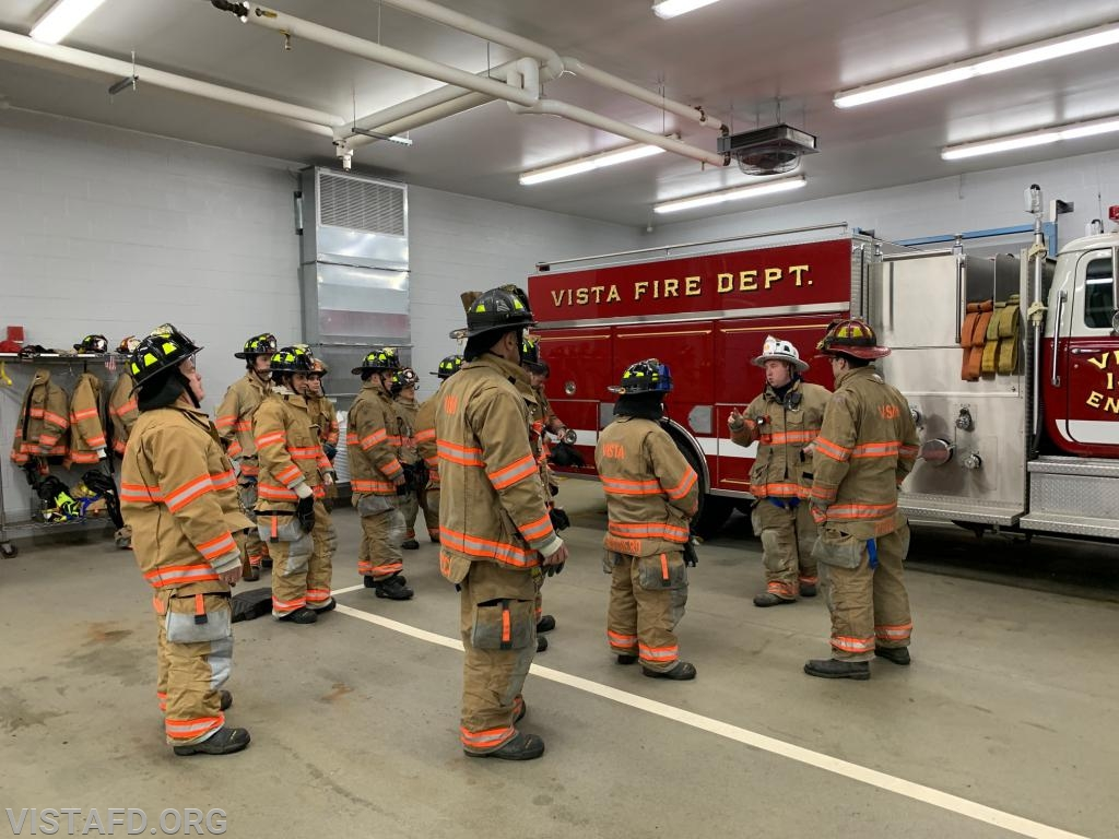Vista Firefighters going over different hose line advancement techniques