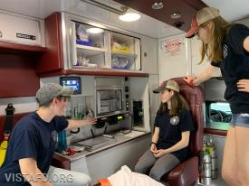 "Foreman Karen Lilly going over radio procedures in Ambulance 84B1 during ""EMT Skills Class"""