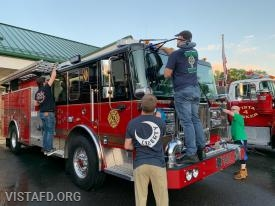 The Engine 141 crew cleaning their apparatus for the 2019 Annual Dinner