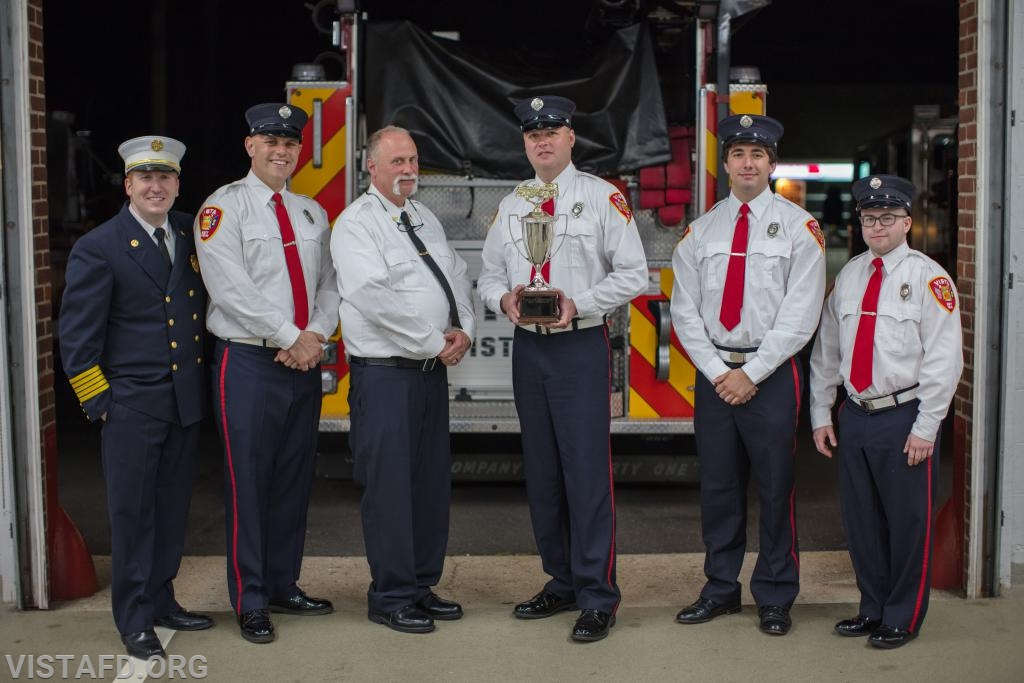 The Engine 141 crew and Chief Jeff Peck with the Best Fire Apparatus Trophy