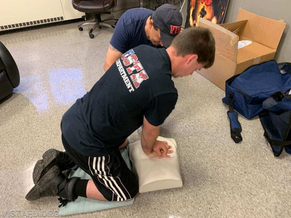 Firefighter Patrick Blasco and Firefighter Martin Rojas performing CPR during the AHA CPR Class