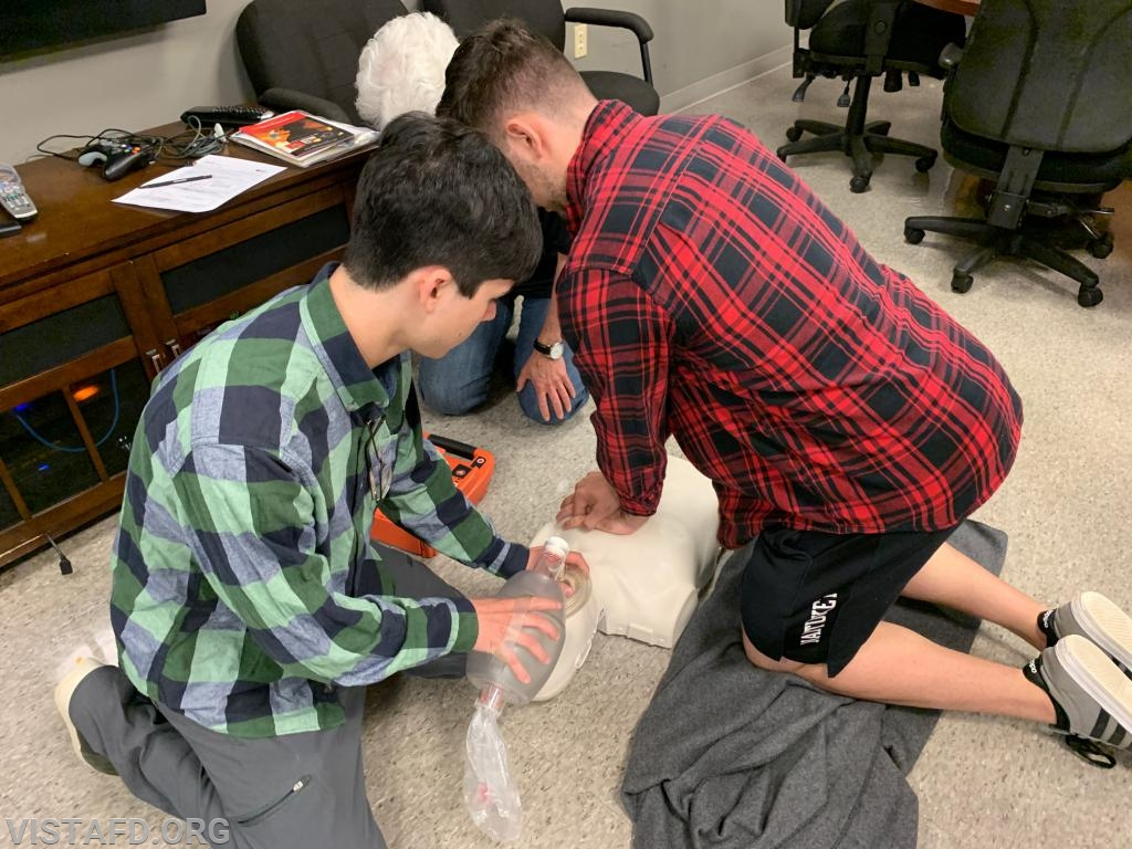 Probationary Firefighter Joe Silvestro and Probationary Firefighter Jacob Agona performing CPR during the AHA CPR Class