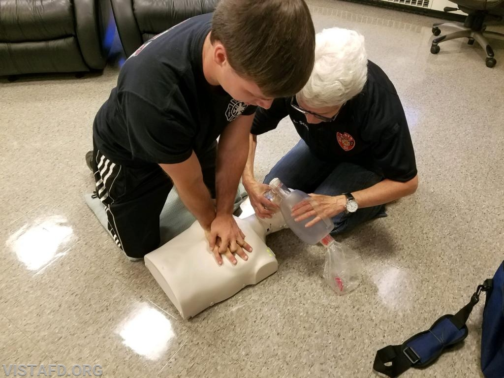 Firefighter Patrick Blasco and Firefighter Lynda Scott performing CPR during the AHA CPR Class