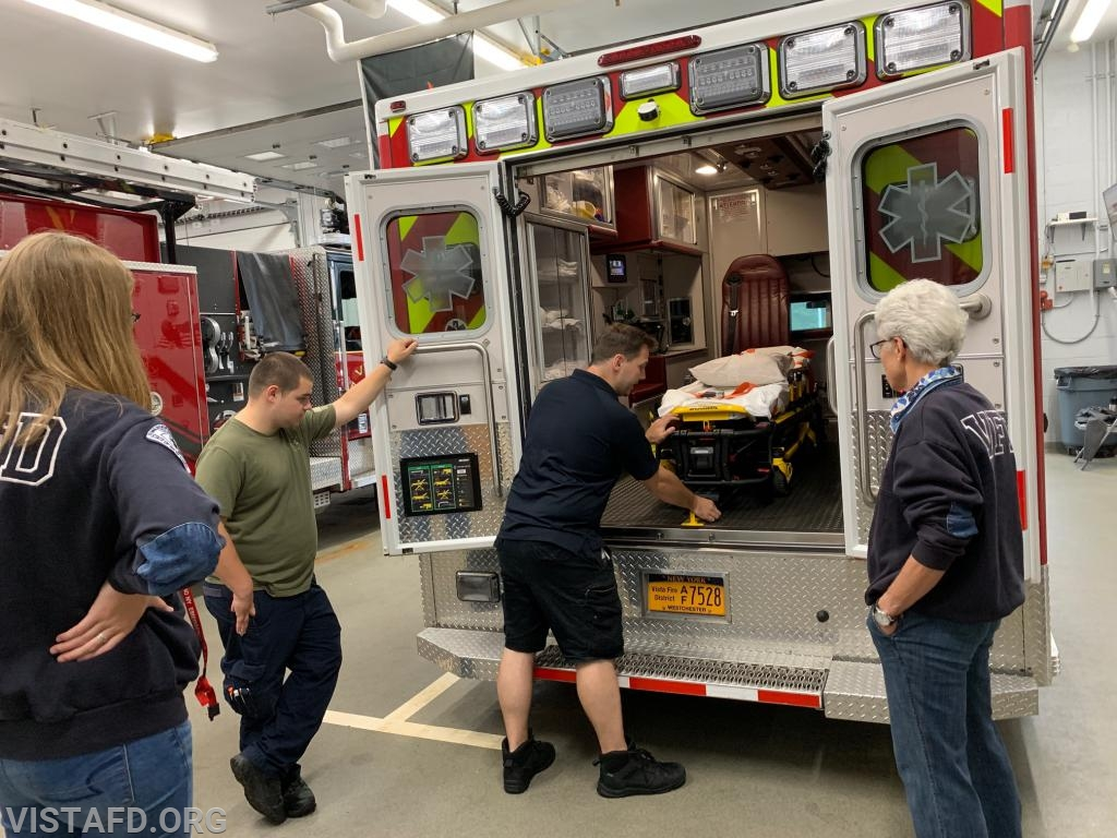 Foreman Mike Canil going over how to operate the Ambulance 84B1 stretcher