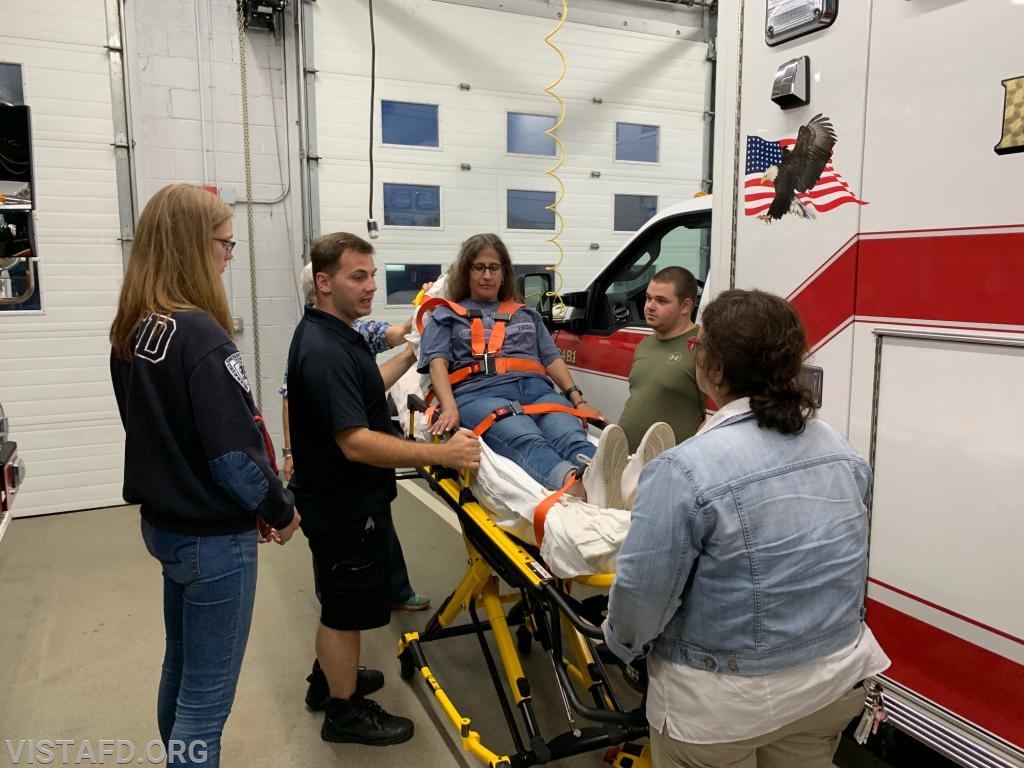 Vista EMS personnel practicing how to operate the stretcher