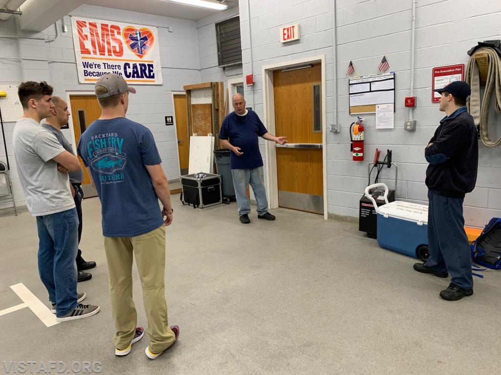 """Ex-Chief Bill Dingee conducting a walkthrough on how to operate an 1-3/4"""" preconnect hoseline"""