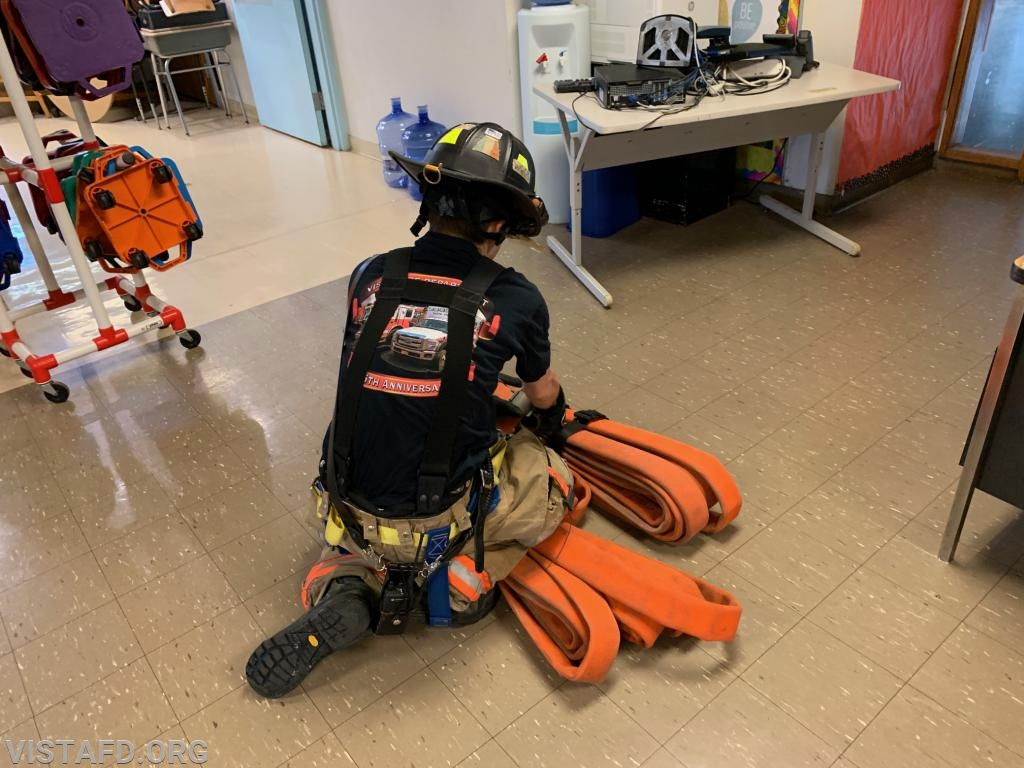 Firefighter Dom Mangone performing an extended stretch