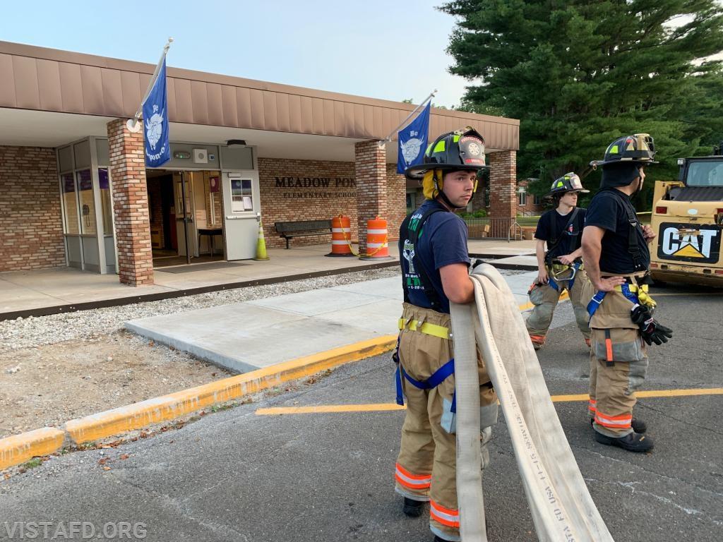 "Firefighter Patrick Blasco stretching the 2-1/2"" hose line"