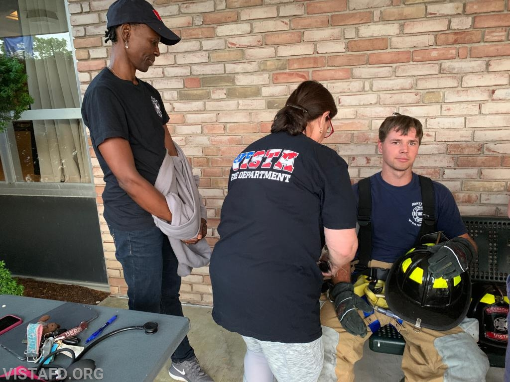 EMT Leslie Smith and Probationary EMT Candidate Judith Le Gall conducting rehab operations