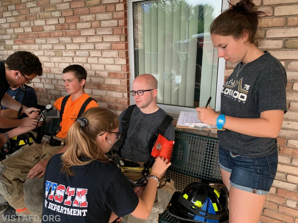 EMT Isabel Fry and FF/EMT Elly Hersam conducting rehab operations